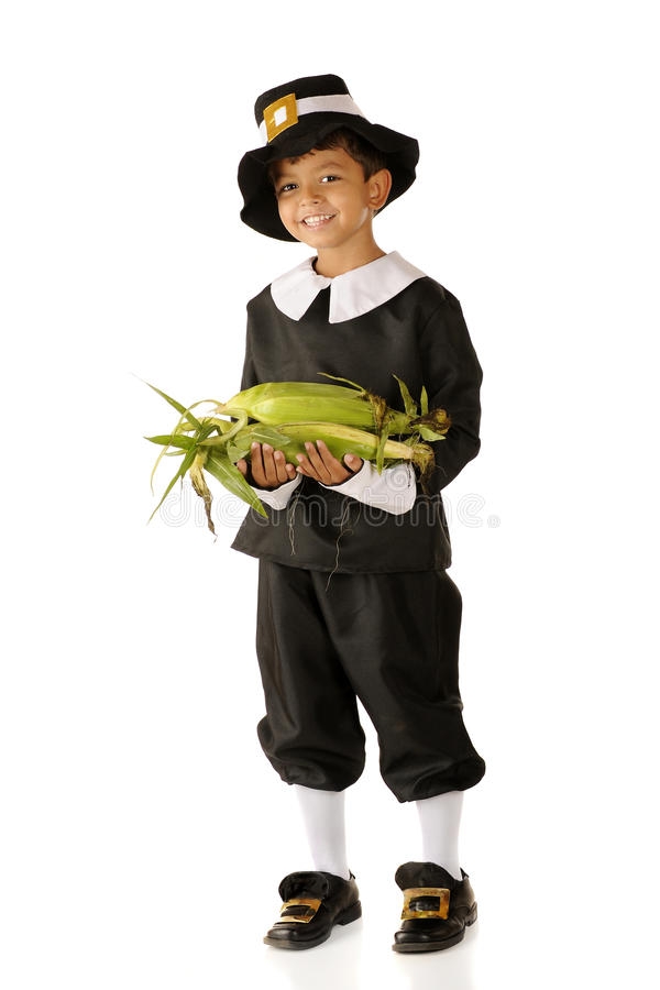 Bringing Corn for Thanksgiving stock photos