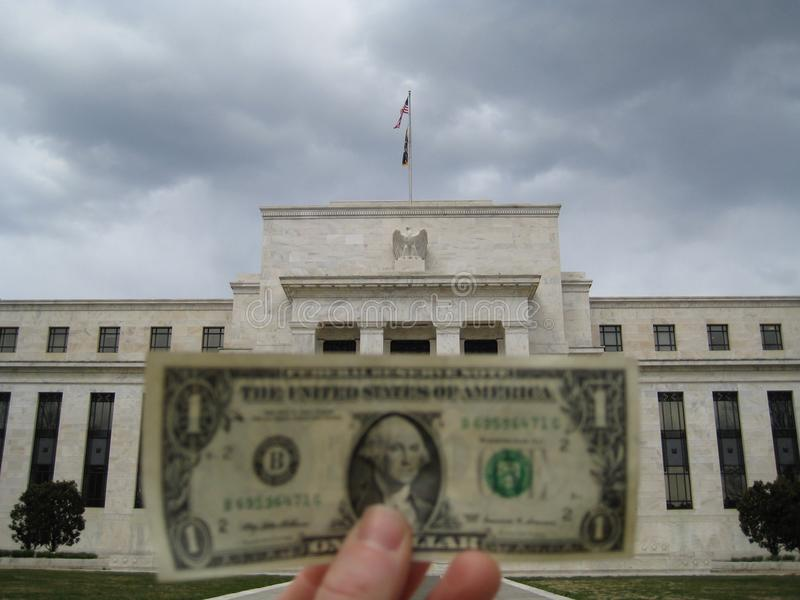 Bringing a dollar bill to the Federal Reserve royalty free stock photos