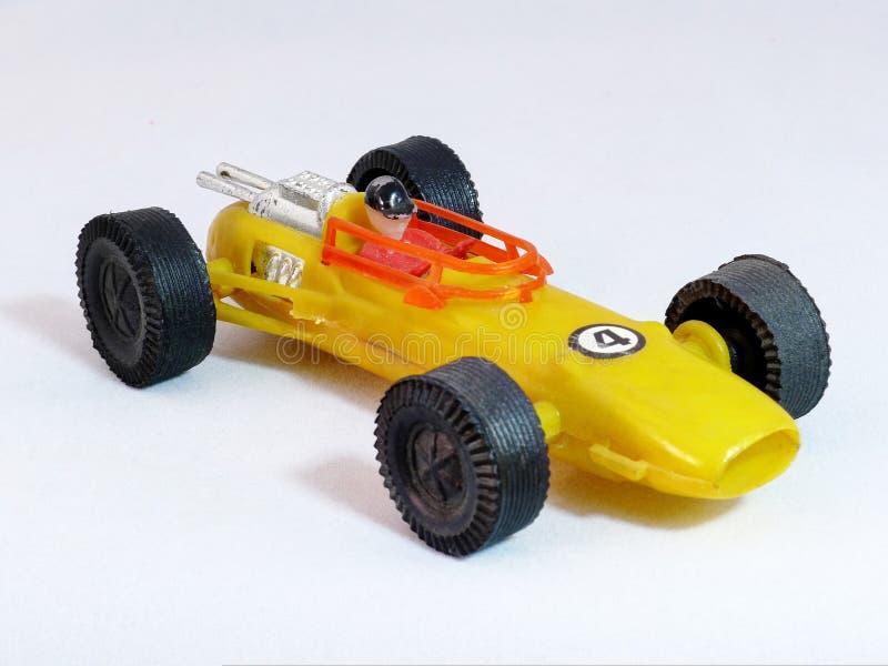 Brinquedo amarelo do carro de corridas fotos de stock