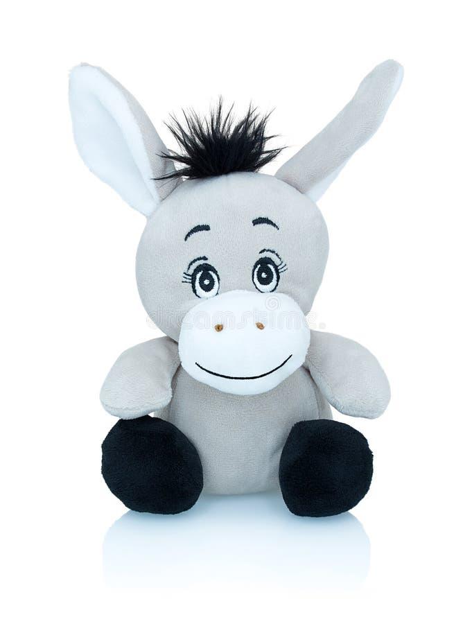 Brinquedo de sorriso cinzento do plushie do asno isolado no fundo branco com reflexão da sombra Brinquedo africano do burro selva foto de stock