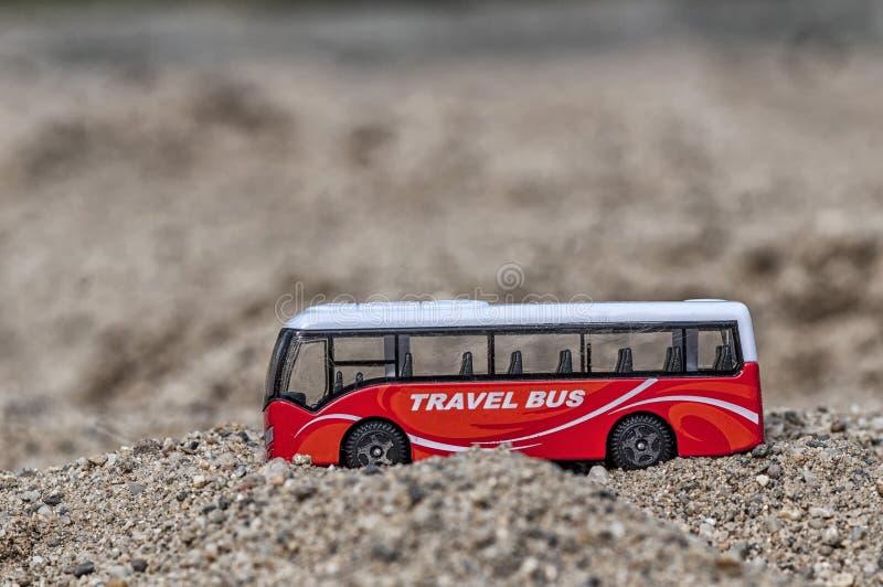 Brinquedo do ônibus do curso fotografia de stock