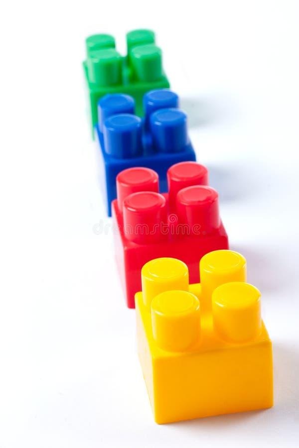 Brinquedo isolado colorido dos blocos de apartamentos imagem de stock royalty free