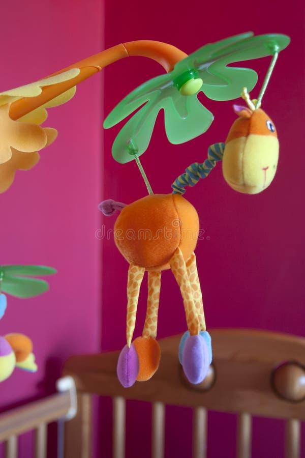 Brinquedo móvel para uma ucha dos bebês fotos de stock