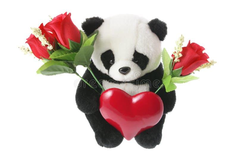 Brinquedo macio da panda com coração do amor fotografia de stock