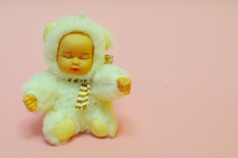 Brinquedo para a menina no tom delicado cor-de-rosa fotografia de stock royalty free