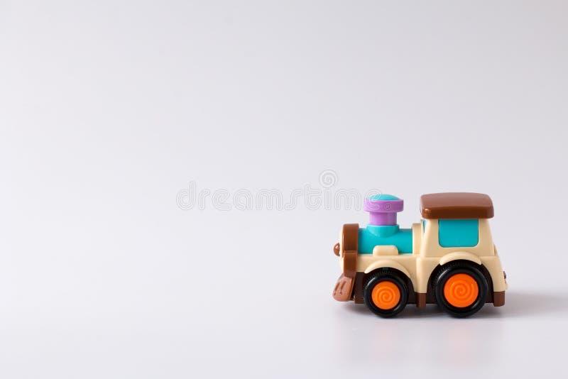 Brinquedo plástico colorido do trem no fundo branco imagem de stock royalty free