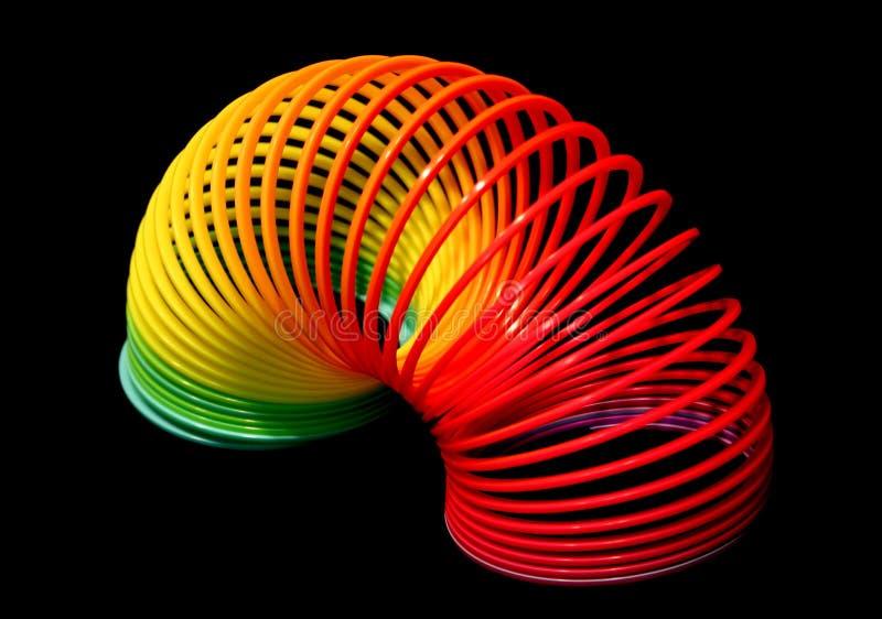 Brinquedo plástico da mola imagem de stock