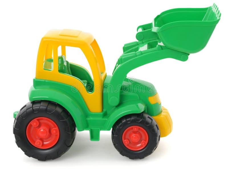 Brinquedo plástico do ` s das crianças, escavadora verde-amarela isolada no branco fotos de stock