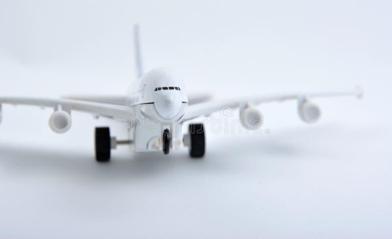 Brinquedo plástico plano isolado no branco fotografia de stock