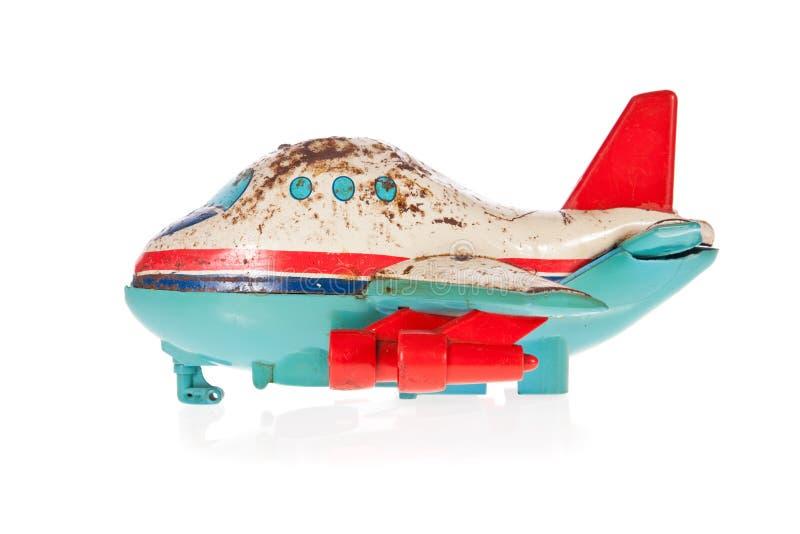 Brinquedo velho do estanho do plano de jato isolado no branco imagem de stock royalty free