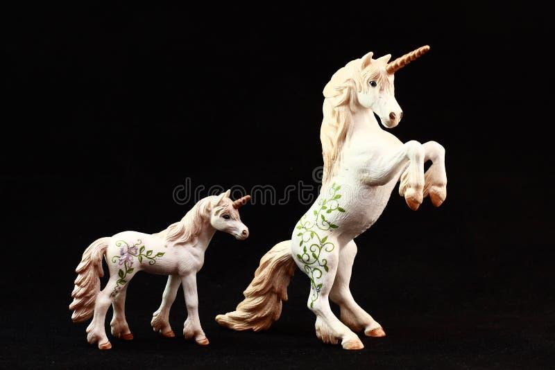 Brinquedos da estatueta do unicórnio imagens de stock