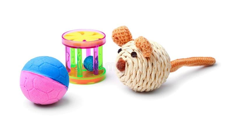Brinquedos plásticos do gato isolados imagem de stock