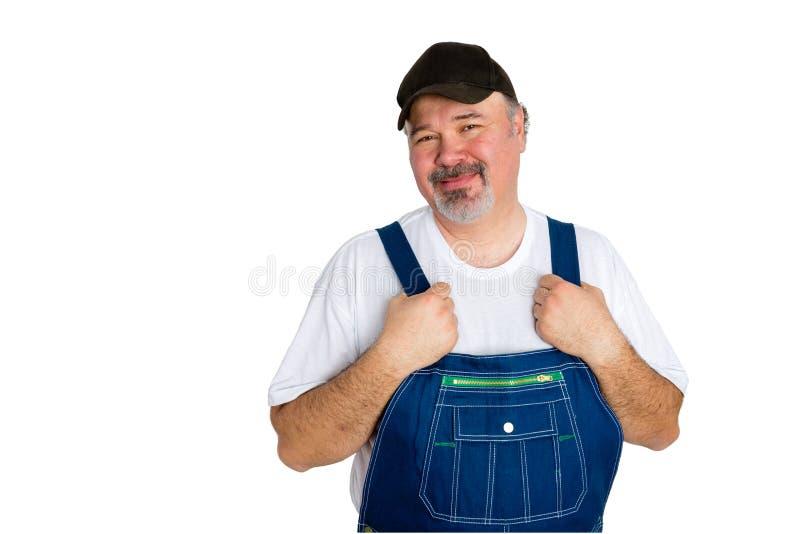 Brins vestindo do homem alegre no fundo branco foto de stock