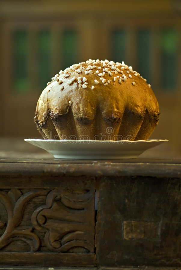 Brioche. On a plate with granulated sugar garnish stock photography