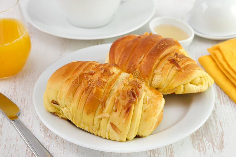 Brioche on the plate with tea. And juice stock images