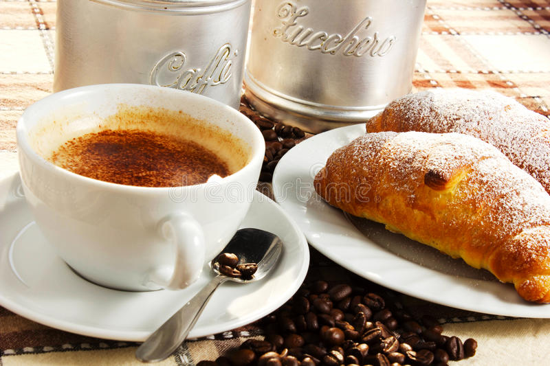Brioches, caffee and Cappuccino royalty free stock photography