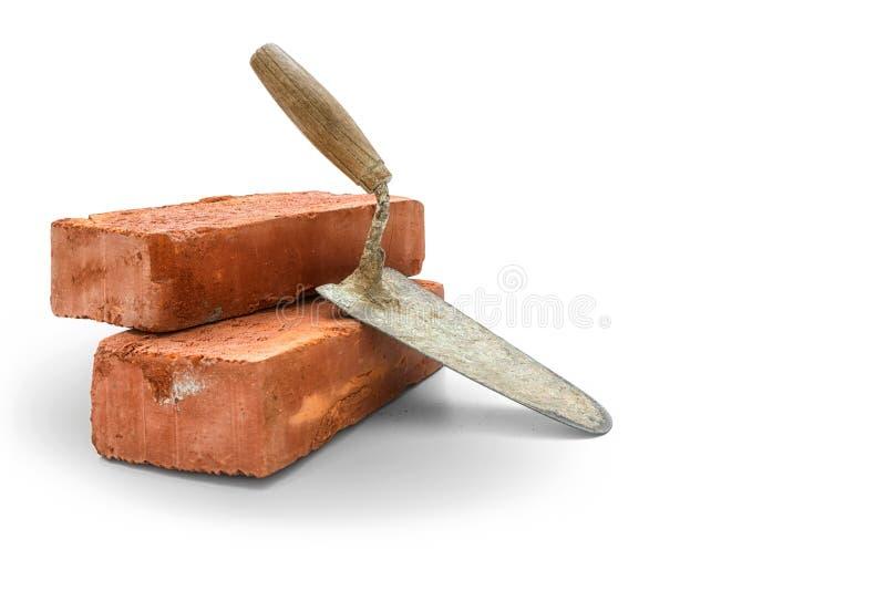 Briques et truelle photographie stock libre de droits