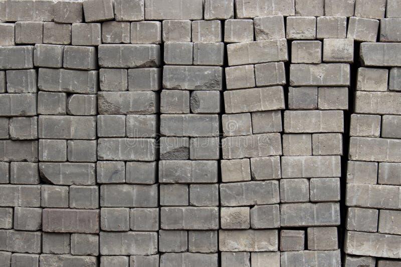 Briques pour les pavés empilés dans les piles, structure de texture de fond image libre de droits
