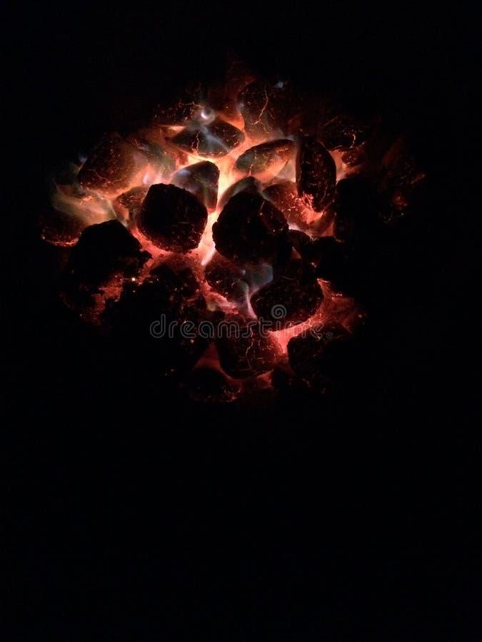 Briquette. Incandescent briquette after barbecue at night stock image