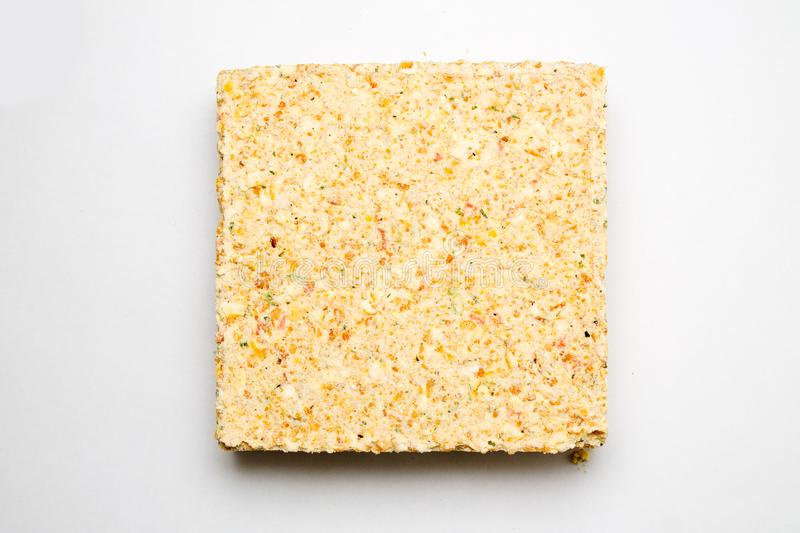 Briquette of pea soup on white background. Sublimate food royalty free stock photo