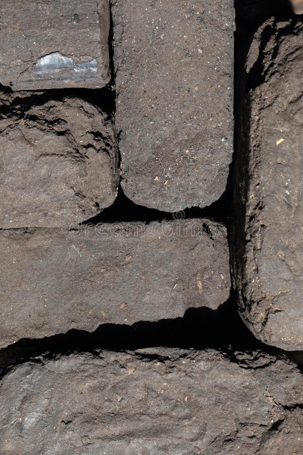 Briquette peat stacked nearby. Close-up. View from above royalty free stock image