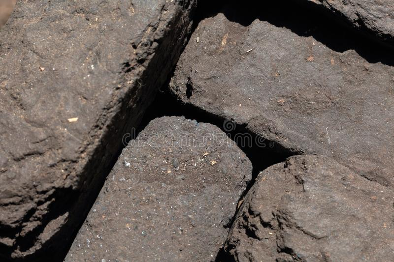 Briquette peat stacked nearby. Close-up. View from above stock image