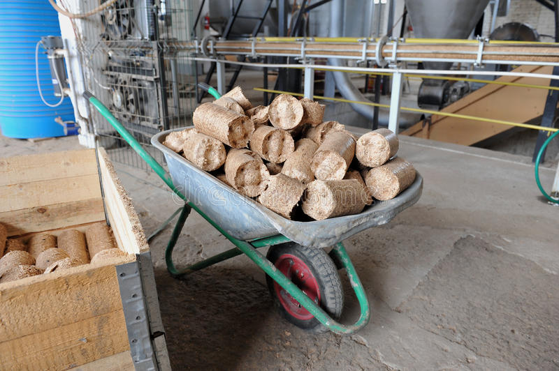 Briquettes. Cart with fuel briquettes in the production royalty free stock photo
