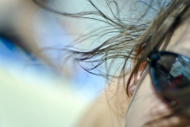 Brisa em seu cabelo fotografia de stock