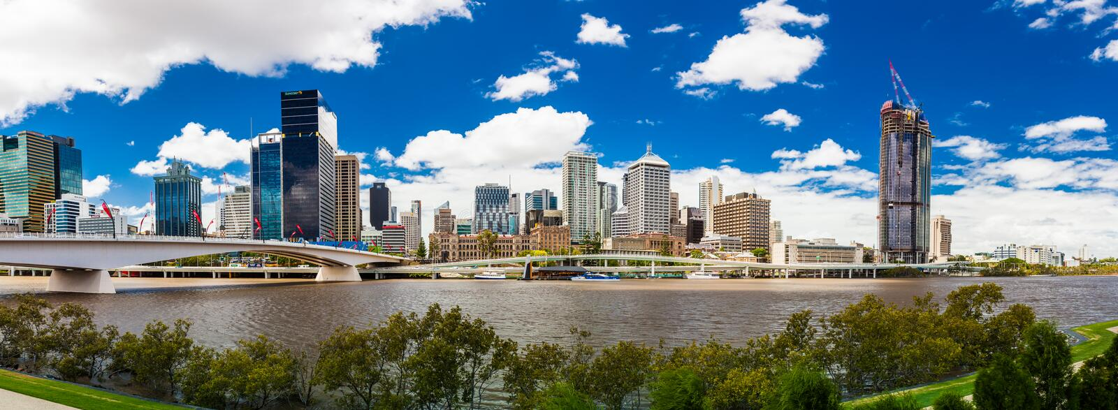 BRISBANE, AUSTRALIA FEB 12 2016: Panoramic view of Brisbane from. South Bank over the river. Brisbane is the capital of QLD and the third largest city in royalty free stock image