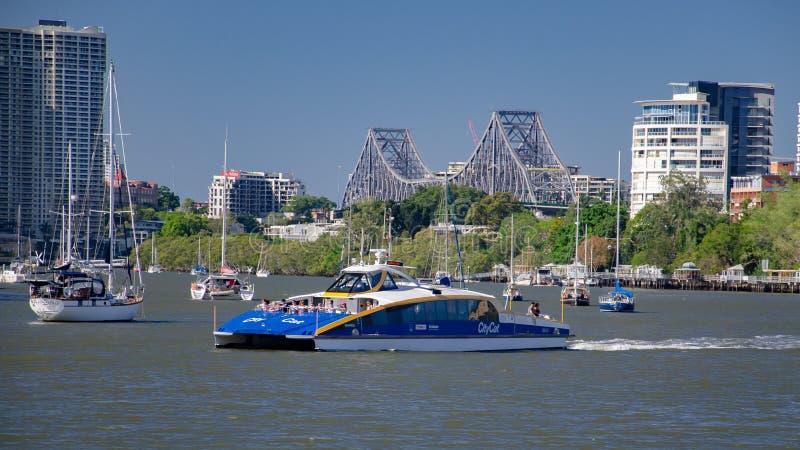 BRISBANE, AUSTRALIA - DECEMBER 29 2013: A Brisbane City Cat ferry makes it`s way down river past the Story Bridge stock photos
