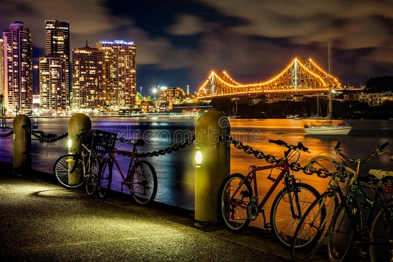 Brisbane River Queensland Australia at Night. Brisbane River walkway at night with Storey Bridge lit up in background Queensland Australia stock image