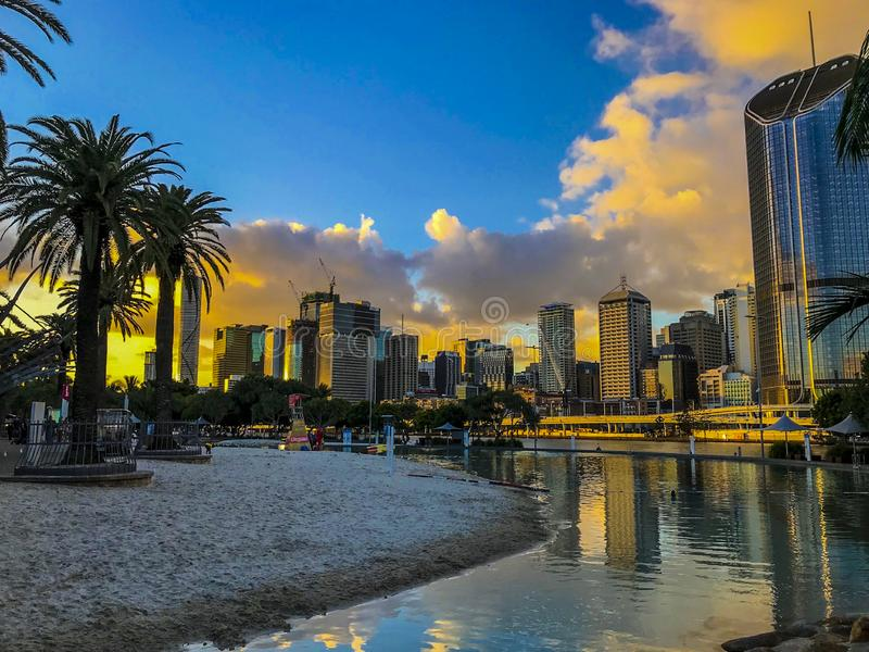 Brisbane during the sunset. Brisbane South Bank during the sunset with pool lagoon royalty free stock photography