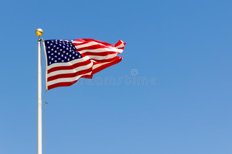A brisk breeze blowing the US flag royalty free stock photos