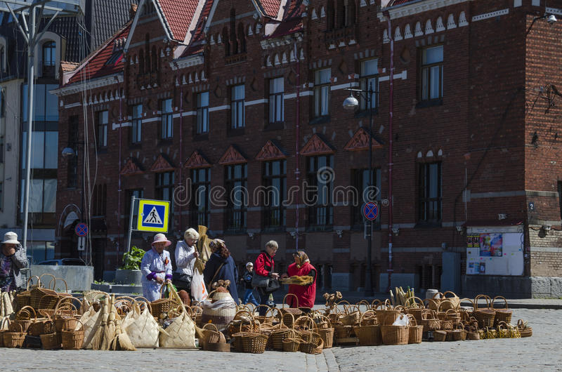 Brisk trade in wicker basket on the square stock photo