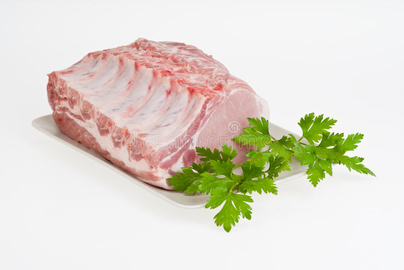 Brisket. With greens on a white plate stock image