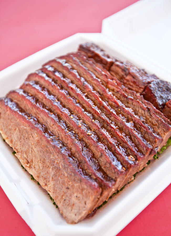 Brisket. BBQ beef brisket on a bed of parsley royalty free stock images