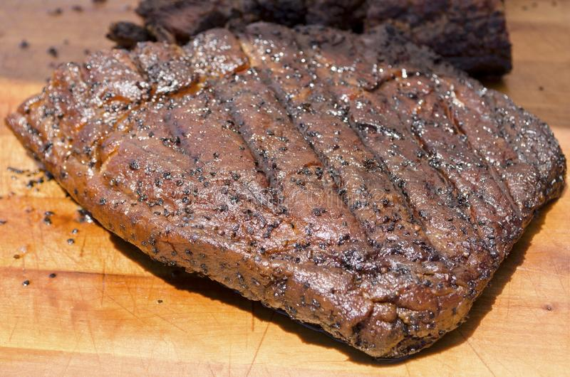 Brisket. Beef brisket on a cutting board ready to carve stock images