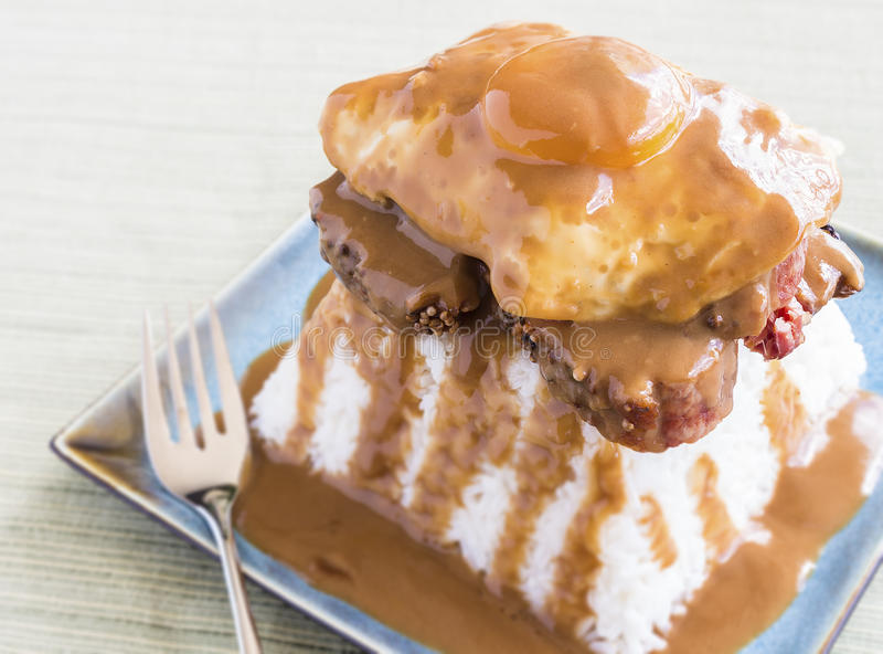 Brisket Loco Moco. Loco Moco, a traditional common Hawaiian food, made by stacking brisket on top of rice, topped with a fried egg and covered in gravy stock photography