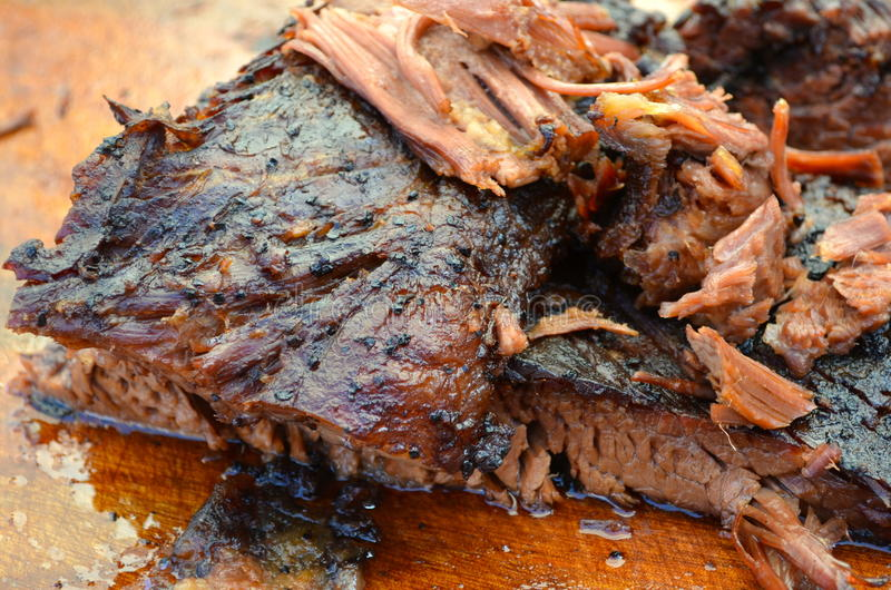 Brisket. A long-cooked tender beef brisket on the cutting board stock photography