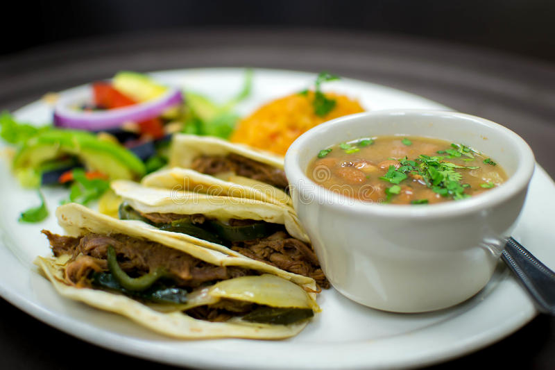 Brisket tacos. Slow roasted brisket with poblano pepper and onions. Flour tortillas stock photo
