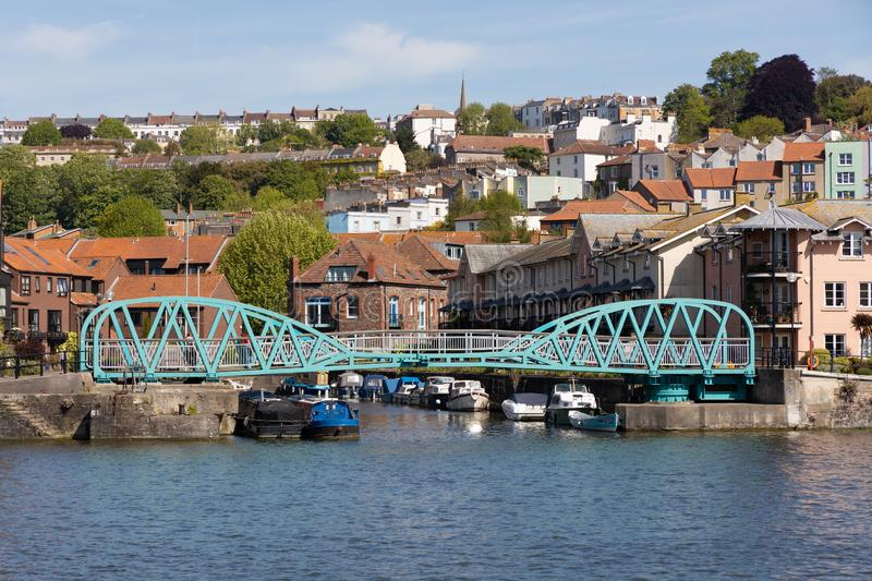 Light blue pedestrian bridge across the River Avon in Bristol on May 14, 2019. One unidentified person stock photography