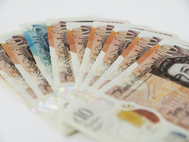 Británicos diez notas de la libra y un cinco en una forma de la fan imágenes de archivo libres de regalías