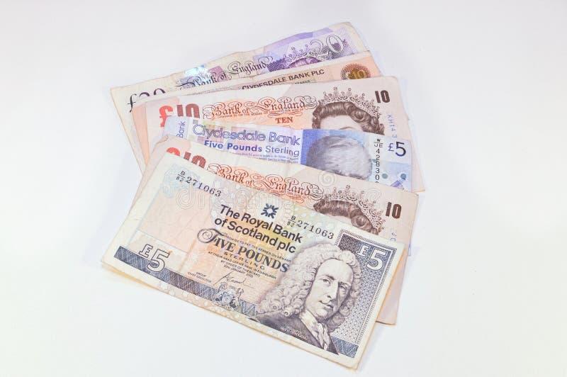 Britannique et écossais martèle le billet de banque images libres de droits