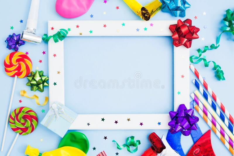 Brithday background with wooden frame and colorful festive accessories royalty free stock images