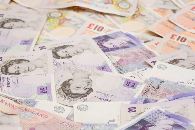 Britische Geldhintergrund-Poundanmerkungen stockfotos