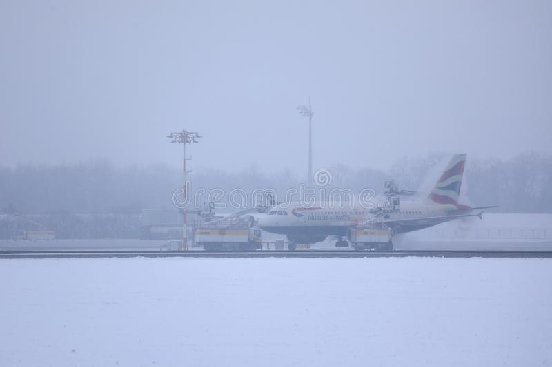 British Airways Airbus taxiing on snow, MUC Airport. British Airways jet doing taxi in Munich Airport, Munchen Flughafen. Winter with snow royalty free stock photos