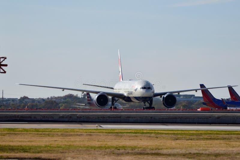 British Airways B777 airplane arriving a the airport gate. November 24th, 2018, British Airways Boeing 777 airplane arriving a the airport gate stock image