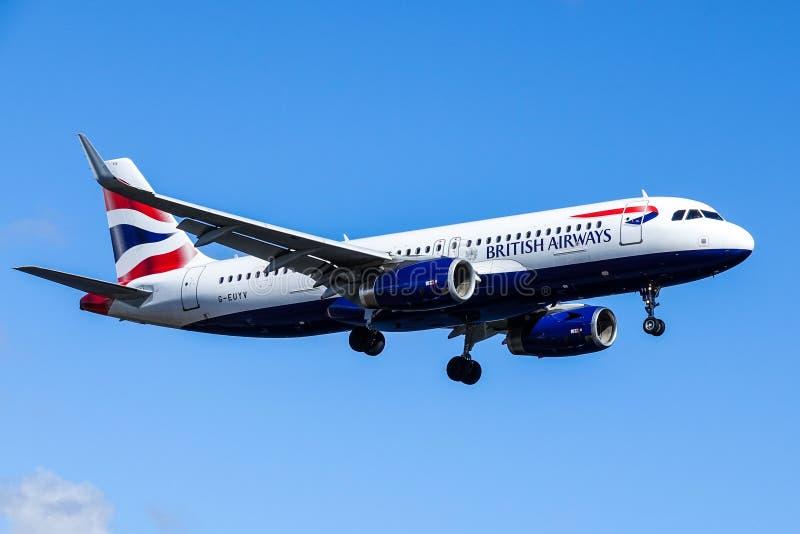 British Airways, BA, Airbus A320 - 232 in air. Arlanda, Stockholm, Sweden - April 27, 2018: British Airways, BA, Airbus A320-232 fly by in blue sky, landing at stock photos