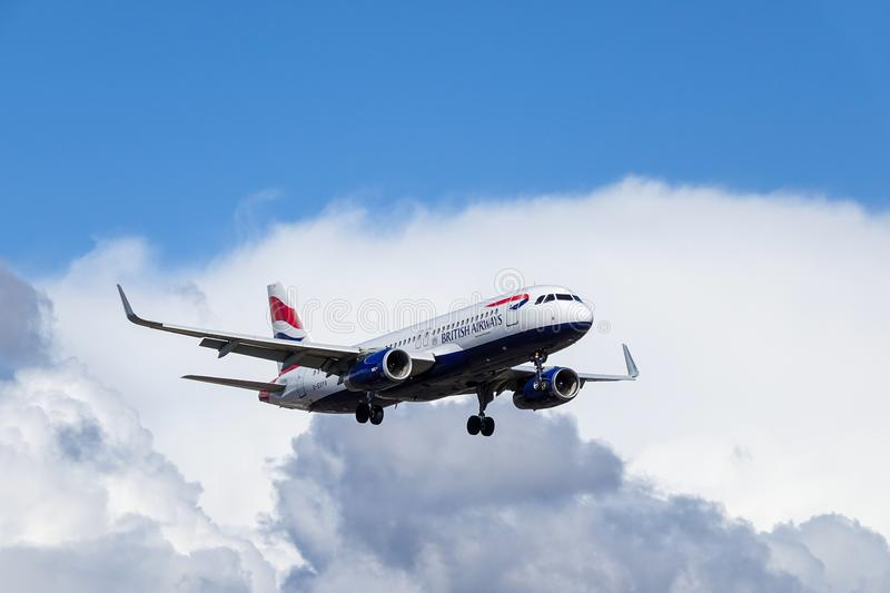 British Airways, BA, Airbus A320 - 232. Arlanda, Stockholm, Sweden - April 27, 2018: British Airways, BA, Airbus A320-232 fly by in white clouds and blue sky royalty free stock photo