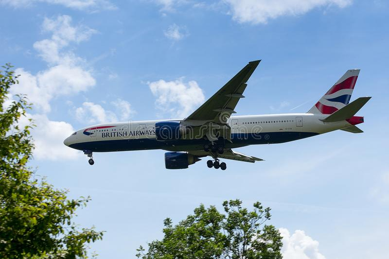 British Airways Boeing 777 low on Approach to Heathrow Airport. British Airways Boeing 777-236 registration G-VIIN low on final approach to Heathrow airport royalty free stock photos